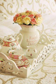 I love the flowers in the water pitcher, what a sweet Breakfast on the patio this would make. :)