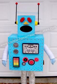 Homemade Toy Robot Costume: Our daughter loves to make things out of boxes. This inspired her to want to be a toy robot for Halloween this year. We let her pick out the color, and