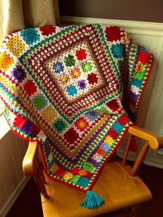 Fabulous crocheted blanket by Dawn Davis.  She designed a playful mix of granny squares and granny stripes.  More photos and info on her blog Fiddlesticks.
