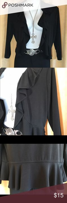 """Ruffle Front Peplum Shrug Black Ruffle Peplum Shrug, Long Sleeve. Size M. Approximate Measurements: Armpit to Armpit 18"""" across when lying flat. Stretches. 95% Polyester, 5% Spandex. Machine Wash. Smoke free, Pet free and Perfume/Fragrance Free Home. Excellent Condition. Dress Barn Sweaters Shrugs & Ponchos"""