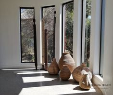 Don't Underestimate The Effectiveness Of Natural Light When Designing Your Space.  In This Cocoa Bean Lodge Project, We Added These Organic Shaped Baskets To Add Emphasis On The Stunning Architectural Curved Passage Design And Beautiful Long Windows Which Added The Perfect Amount Of Natural Light And Interest To The Space.  #CocoaBeanInteriorDesign #cocoabean  #interiordesign #designideas #interiordesignideas #design #bushlodge #lodgedesign #africanvilla #designerhospitality