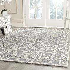 Bring antiqued inspiration and a patterned foundation to any room with this area rug. Machine woven in Turkey from 100 percent polypropylene with latex backing, this synthetic rug's .25-inch pile is embellished with a Persian-inspired, faded motif in an ivory and gray color palette. Use this sophisticated area rug as a warm anchor to a contemporary aesthetic in your living room. Paint paneled walls white with matching trim to contrast wood floors. Roll out this rug, and then top it with a…