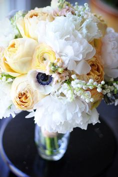 Love the lily of the valley incorporated into this floral