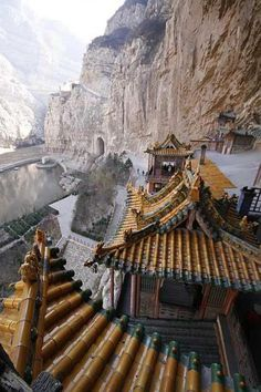 The Hanging Temple, located about 60 km southwest of Datong, China in Shanxi province, is one of the world's forgotten wonders. Clinging to a crag of Hengshan mountain, in apparent defiance of gravity, it consists of 40 rooms linked by a dizzying maze of passageways. The temple is said to have been built by a monk named Liao Ran, during the late Northern Wei Dynasty (386-534 AD) and restored in 1900.