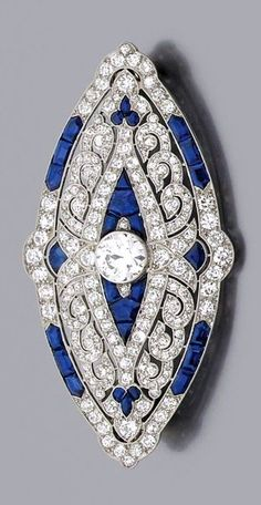 A diamond, sapphire and platinum Art Déco brooch by Mauboussin 1924