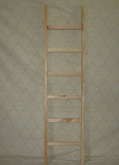 """Wooden 4 Ft Ladder. This Ladder Can Be Used in Many Different Ways. You Can Sit It up Against a Wall and Add Different Primitive Decorations or Hang It on the Wall Decorated with Pip Berries and Metal Stars. You Can Also Put It Sideways on Your Wall and Add Rustic Country Pictures Behind Each Rung to Create a Unique Primitive Piece. You Can Also Stain the Ladders to the Color or Your Decor. These Ladders Are 4 Ft Tall and the Wood Is Approximately 1/2"""" Thick. KENZIE'S STARS AND GIFTS ..."""