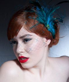 Turquoise Birdcage Veil.  via Etsy. *wonder if it comes in orange?