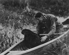 Beaver in canoe with Grey Owl
