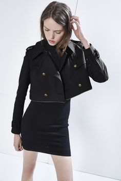Melissa Trench by Rebecca Minkoff.  It is a standard length jacket, but the bottom zips off for a cropped jacket.