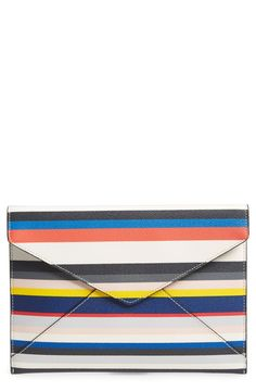 This sharp, trim envelope silhouette is beautifully highlighted by bold stripes, while a lined interior featuring six card slots makes this clutch perfect when traveling light.