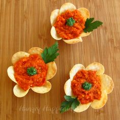 Flower Crisps filled with Creamy Goat Cheese and Roasted Red Pepper Pesto (uses wonton wrappers and a flower cookie cutter)