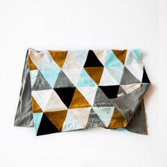 """Orange Crush: Handcrafted Contemporary Patchwork Quilt Throw. The thows of the """"Circus"""" series easily integrate with different home decors. Triangles With their multiple colours triangles, you can use them to decorate a bed, in the living rooms, or even out on a picnic."""