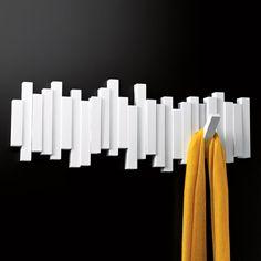 wall mounted coat rack - hide the hooks when not in use - looks like wall art