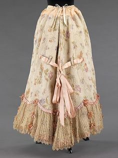 1895–1900 - The back is tied and controlled by those pink ribbons. Very interesting!