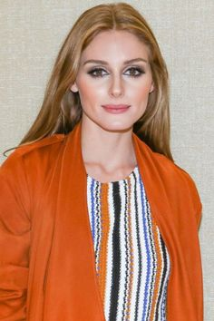 Who: Olivia Palermo What: '70s Beauty Vibes How-To: Palermo played up her burnt orange coat and knit with a matching shade of rich blush that worked like a bronzer to warm up her whole complexion and balanced out the cool tones in her heavy smoky eyes. Editor's Pick: Giorgio Armani Eyes to Kill Quad Shimmers in Mystery, $59, and Cheek Fabric in 305, $46, giorgioarmanibeauty-usa.com.