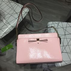 Brand New Pink Kate Spade Purse Brand new light pink Kate Spade handbag. Never been used and still has tag on it. I bought this on sale and they sent me the wrong one, but it was non-returnable and I won't use it. kate spade Bags Shoulder Bags