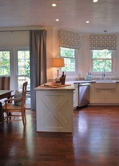 like the gray printed roman shades..and the barnwood look island piece