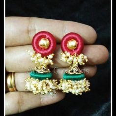 handmade beautiful silk thread loreal jhumka...in red and green colors.  for more plz visit our page https://m.facebook.com/ankaa.creations and plz give us a like.. thank you :)