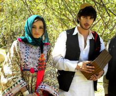Afghan traditional men and women dress. (Pashtun...