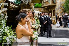 Bridesmaids cry as their friend enters her wedding at the Four Seasons Vail