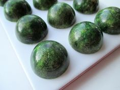 Apple-lime-popping candy white chocolate pralines.