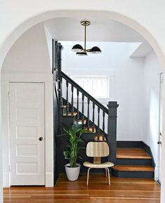 Dark painted stairs accented with white and wood