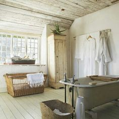 Painted wood floors and ceiling, large basket, tall cupboard