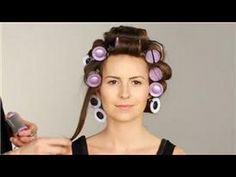 Video on how to put in curlers - big curlers at the top of the head on the 'mohawk' section of hair, only thing I would do differently is turn the ones by the face vertically instead of horizontally