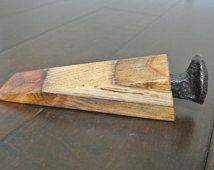 Wood door stop wedge with railroad spike accent