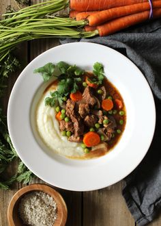 This Crockpot Beef and Vegetables Over Cauliflower Mash recipe is one of my easy go-to weeknight meals when I need something healthy for the family   via aimeemars.com   #BeefStew #CrockpotMeals #CauliflowerMash