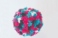 Upgrade a plain pendant shade with colorful pom poms.