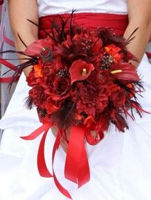 Sassy Bridal Bouquet, a touch of feathers adds life to this bouquet