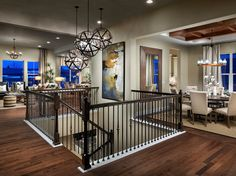 A central staircase leads from the living and dining space to the lower level of The Fraser plan, a new home by Meritage Homes at Richards Farm: The Alpine Collection. Arvada, CO.