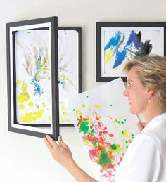 Gorgeous (and neat!) way to display kids art (I need to get a few, ours recently all fell off the wall.. boo), would make a great gift to a grandparent, complete with art too!