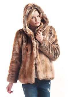 "Rugged yet rich, neutral yet natural, Coyote reigns as one of our most authentic furs. An artful blend of Tan and Camel with Grey and Brown undertones, Coyote's rustic, natural look is matched only by its soft, silky touch. Perfect for this 26"" hooded parka, it's the fabulous addition to your wardrobe that will make you love Winter! From the face-framing hood and European hook closures to the cozy velvet pockets, you'll welcome cold days and an opportunity to wear the coat th..."