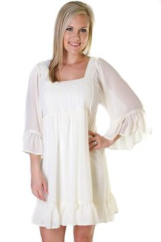 Off white dress with 3/4 ruffle sleeves and crochet detailing neckline. (fully lined) Brittani is wearing a size Small.