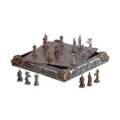 Knights and dragons square-off on a medieval board that adds mystical appeal to the timeless battle of chess. All 32 finely detailed chessmen fit inside the elaborately carved chessboard case. Alabastrite and wood chess set.