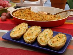 Cheesy Twice-Baked Potatoes : Sour cream, fresh chives and plenty of gooey cheddar combine with thefillingofbakedpotatoes to form a richstuffingin this party-ready side dish.