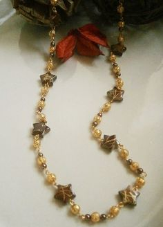 BROWN & GOLD STAR BEADED NECKLACE £12.00http://folksy.com/items/4924392-BROWN-GOLD-STAR-BEADED-NECKLACE