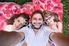 Happy young family taking selfies Royalty Free Stock Photo With coupon codes and promotional codes.