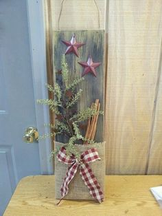 Unusual Burlap Christmas Decoration Ideas Wooden board is decorated with burlap greenery and stars.Wooden board is decorated with burlap greenery and stars. Burlap Crafts, Christmas Projects, Holiday Crafts, Christmas Time, Diy Crafts, Wood Crafts, Christmas Ideas, Burlap Christmas Decorations, Rustic Christmas