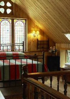 Historic Chapel to Small House Conversion - another loft bedroom highlighting the gorgeous chapel windows