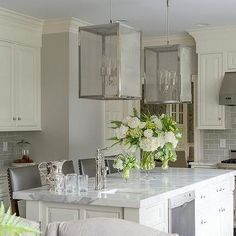 Need a remodeling kitchen idea? Do you want a beautiful Victorian Kitchen? We got you covered in creating your dream house. Check out this Ivory Kitchen Island with Nickel and Mesh Lanterns.