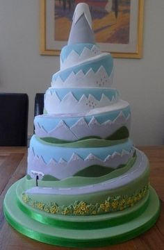 I like how the layers advance from lowest altitude to highest (flowers to just mtns) and I like how tall it is and the slight angles without being too acute. Dont like simplicity of angles Themed Wedding Cakes, Wedding Cake Rustic, Birthday Cake Decorating, Cookie Decorating, Beautiful Cakes, Amazing Cakes, Mountain Cake, Cake Story, Cake Pictures
