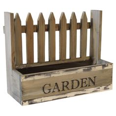 Featuring a picket fence design and distressed finish, this classic planter is perfect for starting a miniature herb garden in the kitchen window.