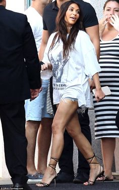 Leggy look! Kim Kardashian showcased her toned legs in ripped shorts and oversize T-shirt as she stepped out in Beverly Hills on Sunday