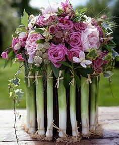 A Natural Vase of Leeks  filled with pretty pink flowers