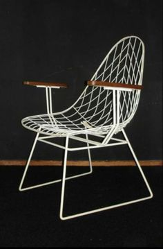 cool wire chair with wooden armrest