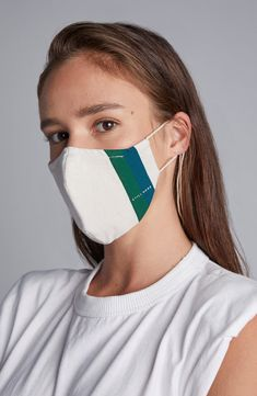 A denim blend of recycled and organic cotton means lightweight comfort in a full-coverage face mask with adjustable-tie ear straps for a custom fit.