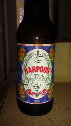 Harpoon IPA - Pours a golden yellow color with just a hint of amber. A pillow-like finger and a half of head that sticks around a bit and leaves nice lacing. This IPA hits you with earthier hop aromas than it's citrusy west coast brethren. Floral, pine, resin, and just a slight hint of citrus. Nothing that will blow socks off but balanced and complex nonetheless. Pleasant amount of hop bitterness up front with a continuation of the earthy hops.